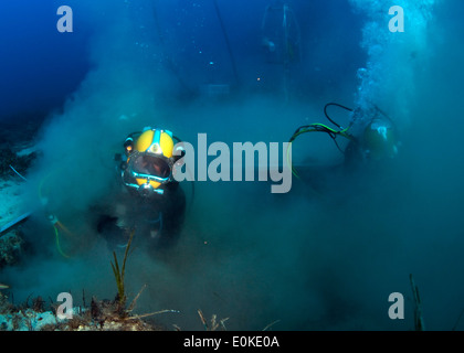 Navy Diver 2nd Class Cody Creger, assigned to Mobile Diving and Salvage Unit 2, Company 4, operates a suction dredge - Stock Photo