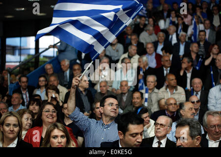 Thessaloniki, Greece . 15th May, 2014. New Democracy political party supporter wavew a Greek flag. Greek Prime Minister - Stock Photo