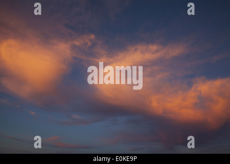 Colorful clouds in the sky at sunset - Stock Photo
