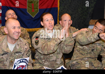 Soldiers stationed at Bagram Airfield, Afghanistan, defy sleep as they watch game 2 of the world series live, which - Stock Photo