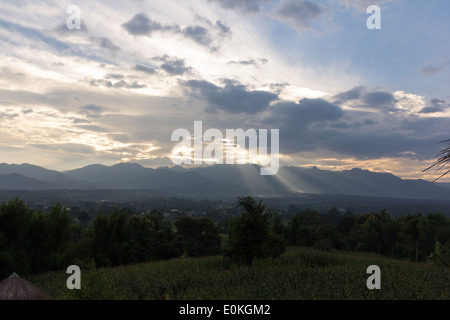 ray of sunshine breaks through the storm clouds - Stock Photo