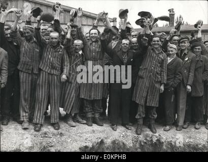 May 05, 1945 - Prisoners at the Electric Fence cheer the Americans after Dachau concentration camp was liberated. - Stock Photo