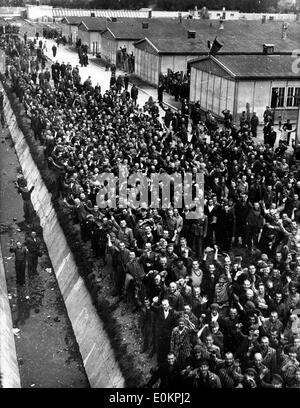 Political prisoners cheer madly as they hear guns of the 42nd Rainbow Division as they approach Dachau - Stock Photo