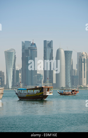 Doha. Qatar. Traditional Dhows & skyscrapers of the West Bay skyline. - Stock Photo