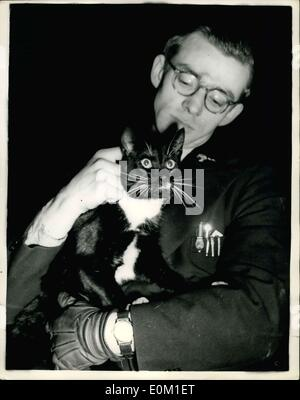 Jan. 30, 1953 - Cat Rescued From 100 ft High Water Tower. R.S.P.C.A Man With the Cat; A cat which yesterday defied all efforts to be rescued - was this morning brought down from the top of the 100 ft. high water tower on which it was trapped - at Popler Power Station. Fireman and R.S.P.C.A. officer Frank Shenfiell - seen with the cat after the rescue today.