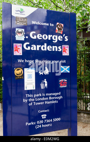 Sign for St George's Gardens in East London, covered in anti-fascist stickers. Park is next to the Battle of Cable - Stock Photo