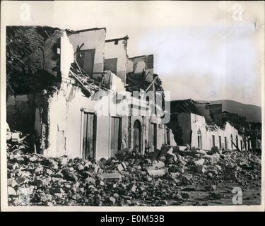 Aug. 08, 1953 - Greek Earthquake Disaster. Photo shows This row of houses are shattered wrecks are the read is piled - Stock Photo