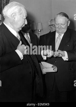 German President Theodor Heuss and Ludwig Erhard during a gala - Stock Photo