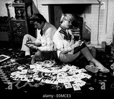 Actor Roger Moore and his wife Dorothy Squires surrounded by photographs - Stock Photo