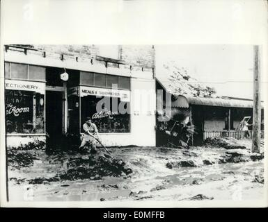 Mar. 03, 1955 - Disastrous floods in New South Wales.. Shop filled with Mud: Photo shows a shopkeeper busily at - Stock Photo