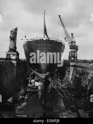 RMS Queen Mary ocean liner at King George V graving dock - Stock Photo