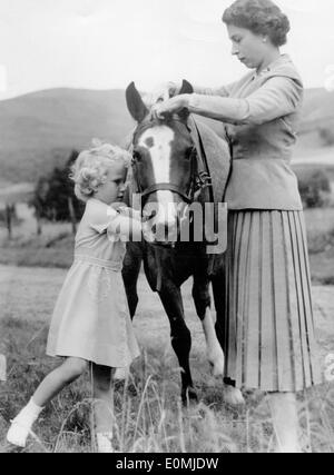 Queen Elizabeth II and Princess Anne with a pony at Balmoral Castle - Stock Photo