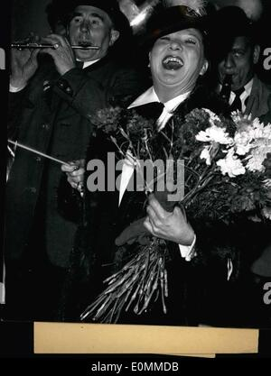 Dec. 12, 1955 - Mome Moineau arrived in Munich. The French Millionaire Mome Moineau today arrived in Munich with - Stock Photo