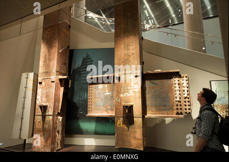 New York, NY, USA. 15th May, 2014. A visitor to the National September 11 Memorial Museum looked at some of the - Stock Photo