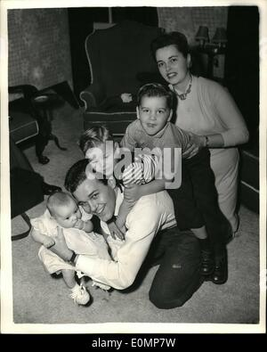Apr. 04, 1956 - American Actor And His Family In London: A happy family picture of American actor Jack Drummond, - Stock Photo