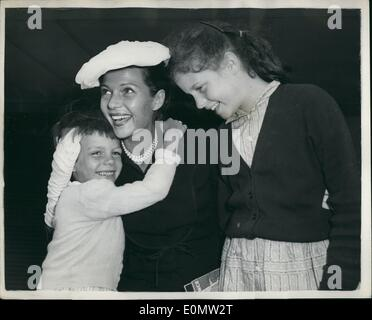 Jul. 07, 1956 - Rita Hayworth and her Daughters : Photo shows Film actress Rita Hayworth, who arrived in London - Stock Photo