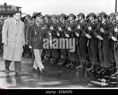 Franz Josef Strauss and Alfred Gruenther inspect troops - Stock Photo