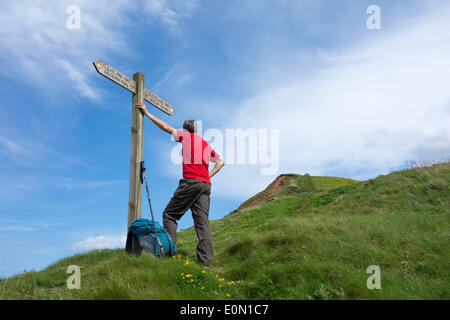 Walker on The Cleveland Way National Trail at Skinningrove between Saltburn and Staithes, North Yorkshire, England, - Stock Photo