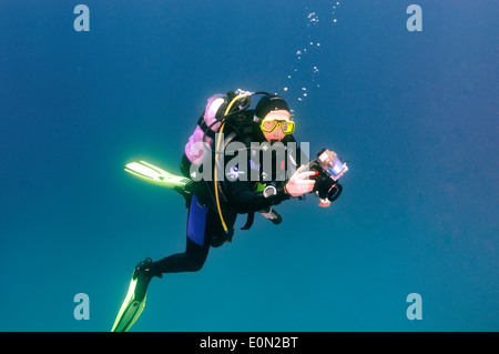 Scuba diver with camera - Stock Photo
