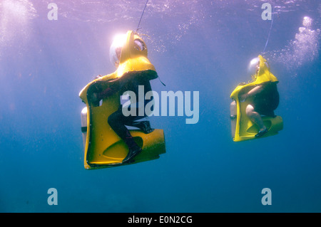 Two BOB 'The Breathing Observation Bubble' scooter divers underwater in Tenerife - Stock Photo