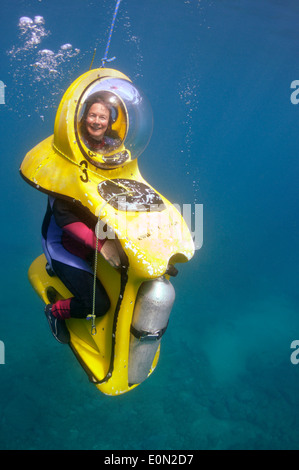BOB 'The Breathing Observation Bubble' scooter diver underwater in Tenerife - Stock Photo