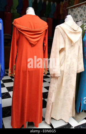 Moroccan dresses for sale in Marrakesh. - Stock Photo