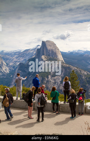 Visitors viewing half dome from Glacier point Yosemite national park California USA - Stock Photo