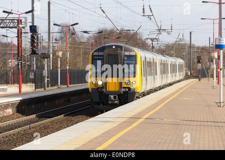 Manchester to Glasgow TransPennine Express Class 350 Desiro EMU train arriving at Wigan North Western Station. - Stock Photo