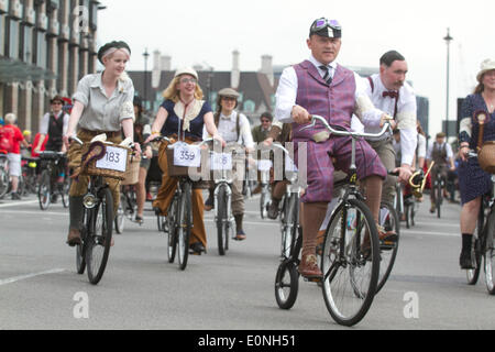 Westminster London UK. 17th May 2014. Cyclists dressed in tweed coats and cravats  riding penny farthings take part - Stock Photo