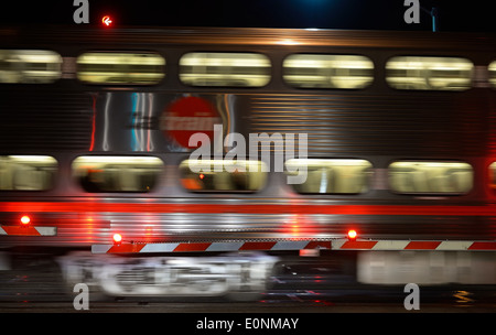 A Caltrain at a railroad crossing in Mountain View, CA - Stock Photo