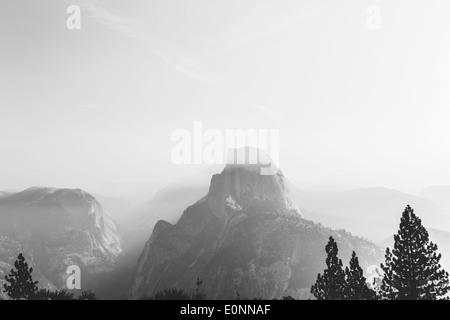 view from Glacier Point in Yosemite on a foggy morning in black and withe - Stock Photo