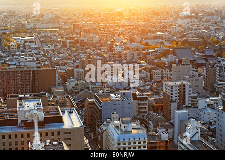 Sunset over Kyoto City in Japan, view from Kyoto Tower - Stock Photo