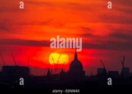 London, UK. 17th May, 2014. Dramatic sunset over St. Paul's Cathedral in London Credit:  Guy Corbishley/Alamy Live - Stock Photo