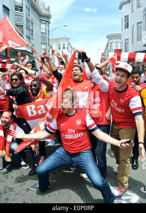 arsenal fans celebrate FA cup championship win on Grant Street San Francisco - Stock Photo