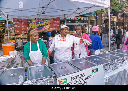 Hells Kitchen, New York City, Saturday, May 17 2014, USA: the smiling ladies of Morrel's Catering jousting with - Stock Photo