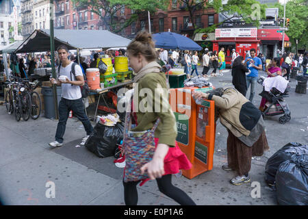 Hells Kitchen, New York City, Saturday, May 17 2014, USA: sidewalk scene behind the booths on opening day of 2 day - Stock Photo