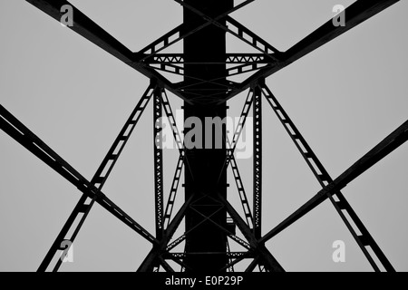 Train Trestle seen from below in black and white - Stock Photo