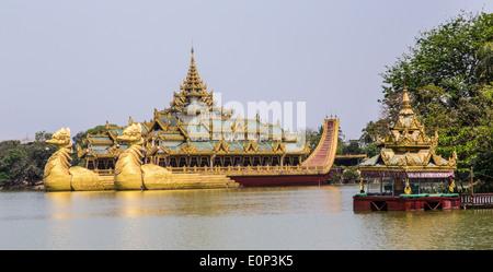 The 'Karaweik', a facsimile Royal Barge on the Kandawgyi Lake in Yangon - Stock Photo