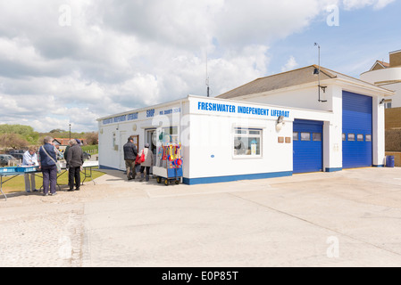 People both men and women browsing items for sale at the freshwater independent lifeboat shop which is a registered - Stock Photo
