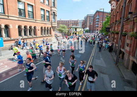 MANCHESTER, UK. 18th May 2014. Thousands of competitors take part in the 2014 Bupa Great Manchester Run, which is - Stock Photo
