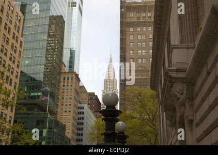 Looking up and east along 42nd Street from an entrance of the NY Public Library. Chrysler Building in the background. - Stock Photo