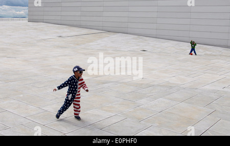 Children Playing on the Roof of Oslo Opera House - Stock Photo