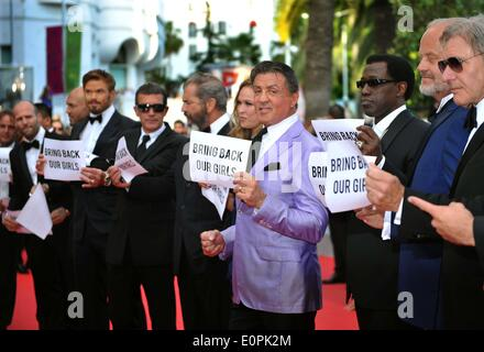 (140518) -- CANNES, May 18, 2014 (Xinhua) --  Cast of 'The Expendables 3', holding up banners reading 'Bring back - Stock Photo