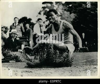 Nov. 11, 1956 - The Happy Athlete from Nigeria. Peter Esirt jumps over Seven Metres - at Melbourne: In a very happy - Stock Photo
