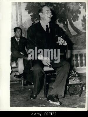 Dec. 12, 1956 - Screen Star Turns Producer... John Wayne in Italy. Popular screen star John Wayne has turned to - Stock Photo