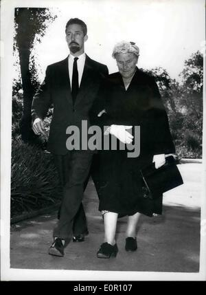 Aug. 08, 1957 - Inquest on Antony Beauchamp. The inquest opened today at St. Pancras Coroner's Court, on the 29-year old society Photographer, Antony Beauchamp, who was found dead in his Hyde Park Gardens flat on Sunday. Photo Shows The dead men's mother, Mrs. Florence Entwistle - Vivienns, the photographer and his bother, Mr. Clive Entwistle - seen arriving at the Cornoner's Court today.