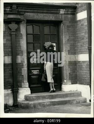 Aug. 08, 1957 - Lady Jane visits Paddington Mortuary: Lady Jane Vane-Tempest-Stewart, who received a telephone call from 39-year old society photographer, Antony Beauchamp at 4.a.m. on Sunday and called the police who found him dead at his London flat - yesterday went to Paddington mortuary where the body was taken. Photo shows Lady Jane Vane-Tempest-Stewart, with her head covered in a scarf, waits to go into Paddington mortuary yesterday.