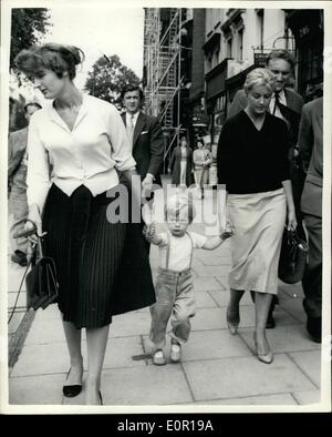 Aug. 08, 1957 - Lady Jane visits Paddington Mortuary: Lady Jane Vane-Tempest-Stewart, who received a telephone call from 39-year old society photographer, Antony Beauchamp at 4.a.m. on Sunday and called the police who found him dead at his London flat - yesterday went to Paddington mortuary where the body was taken. Photo shows Lady Jane Vane-Tempest-Stewart (right), walking in London yesterday with her sister Lady Annabel Birley and her nephew Rupert Birley.