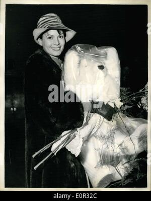 Dec. 27, 1957 - The Marquis Of Milford Haven Visits Eva Bartok And Her Baby; Film Star Eva Bartok, who gave birth - Stock Photo