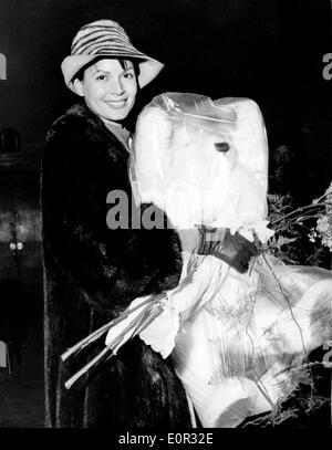Actress Eva Bartok arriving at the airport carrying a huge teddy bear - Stock Photo